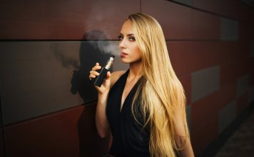 young girl is vaping